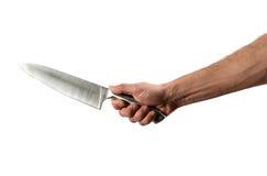 Mano masculina que sostiene el cuchillo afilado Imagen de archivo libre de regalías