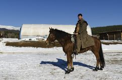 Mano n a horse back in a horse base. Man on a horse back in a horse base. Selective focus Royalty Free Stock Photos