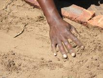 Mano negra de los trabajadores Imagen de archivo libre de regalías