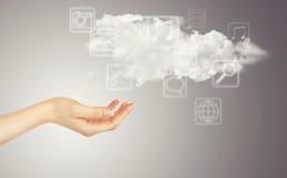 Mano, nube e iconos de los multimedia Imágenes de archivo libres de regalías