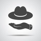 Mano piana che mostra icona black hat Immagini Stock