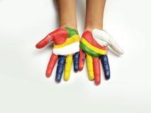 Mano pintada color del niño Fotografía de archivo