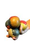 Mano por completo de bolas que hacen juegos malabares Fotografía de archivo libre de regalías
