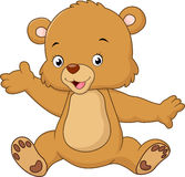 Mano que agita del oso de peluche de la historieta Imagen de archivo libre de regalías