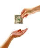 Mano que da el dinero a la otra mano aislada Imagen de archivo libre de regalías