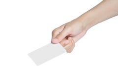 Mano que da la tarjeta en blanco blanca Imagen de archivo