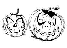 Mano que dibuja dos calabazas de Halloween Imágenes de archivo libres de regalías