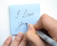 ¡Mano que escribe te amo! Foto de archivo
