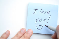 ¡Mano que escribe te amo! Imagen de archivo