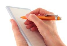 Mano que escribe una lista aislada en blanco fotografía de archivo