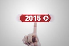 Mano que hace clic un botón futurista Imagen de archivo libre de regalías