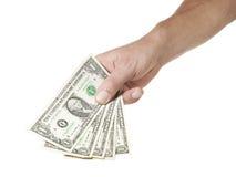 Mano que lleva a cabo cinco billetes de dólar Imágenes de archivo libres de regalías