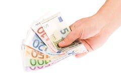 Mano que lleva a cabo euro Imagenes de archivo