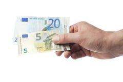 Mano que lleva a cabo 25 euros imagen de archivo libre de regalías