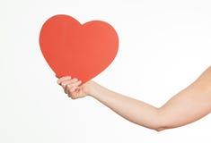 Mano que lleva a cabo forma del corazón Imágenes de archivo libres de regalías