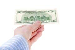 Mano que lleva a cabo la cuenta de dólar de ciento. Imágenes de archivo libres de regalías