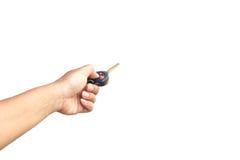 Mano que lleva a cabo llave del coche Imagen de archivo