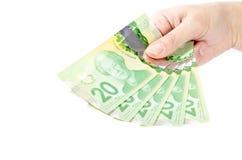 Mano que lleva a cabo los billetes de dólar #3 del canadiense veinte Fotos de archivo libres de regalías