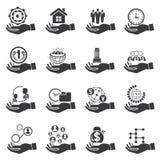 Mano que lleva a cabo los símbolos del negocio, concepto del negocio Fotografía de archivo