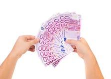 Mano que lleva a cabo notas euro Foto de archivo libre de regalías