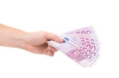 Mano que lleva a cabo notas euro Imágenes de archivo libres de regalías