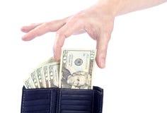Mano que lleva a cabo un veinte dólares americanos Bill Imagen de archivo
