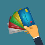 Mano que lleva a cabo vector de la tarjeta de crédito Imágenes de archivo libres de regalías