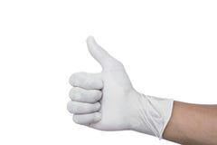 Mano que lleva el pulgar médico de la demostración del guante para arriba Imagenes de archivo