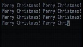 Mano que mecanografía las palabras de la Feliz Navidad que escriben en el viejo cierre llevado blanco de la pantalla de la pantal libre illustration