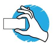 Mano que muestra una tarjeta en blanco Fotografía de archivo libre de regalías