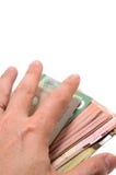 Mano que oculta el escondite de billetes de banco canadienses Foto de archivo libre de regalías