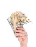 Mano que sostiene billetes de banco del dólar Fotografía de archivo