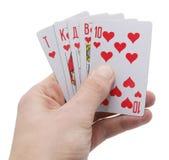 Mano que sostiene cinco jugar-tarjetas fotografía de archivo