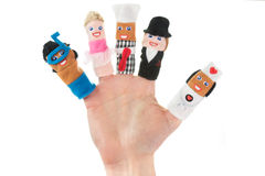 Mano que sostiene cinco marionetas del finger Foto de archivo libre de regalías