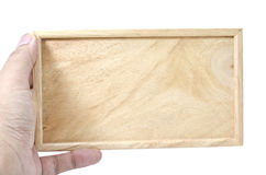 Mano que sostiene de madera llano Fotos de archivo