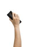 Mano que sostiene el borrador de la etiqueta de plástico Imagenes de archivo
