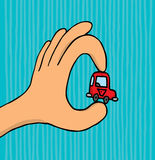 Mano que sostiene el coche minúsculo Foto de archivo libre de regalías