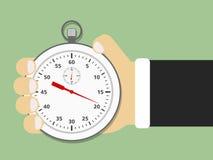 Mano que sostiene el cronómetro Foto de archivo libre de regalías