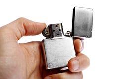 Mano que sostiene el encendedor del vintage Imagen de archivo libre de regalías