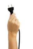 Mano que sostiene el enchufe eléctrico Imagen de archivo libre de regalías
