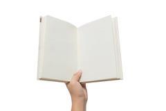 Mano que sostiene el libro blanco en blanco Fotos de archivo