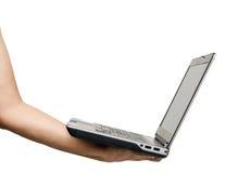 Mano que sostiene el ordenador portátil Imagen de archivo libre de regalías