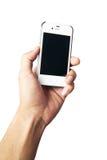Mano que sostiene el teléfono celular blanco Imagen de archivo libre de regalías