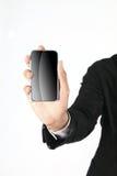 Mano que sostiene el teléfono elegante Imágenes de archivo libres de regalías