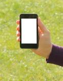 Mano que sostiene el teléfono elegante fotos de archivo libres de regalías