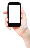 Mano que sostiene el teléfono elegante aislado Foto de archivo libre de regalías