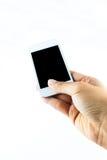 Mano que sostiene el teléfono elegante móvil fotografía de archivo