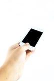 Mano que sostiene el teléfono elegante móvil Fotos de archivo libres de regalías