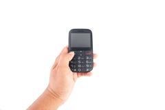 Mano que sostiene el teléfono móvil Fotografía de archivo libre de regalías