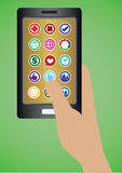 Mano que sostiene el teléfono móvil con los iconos redondos de Apps Imagen de archivo